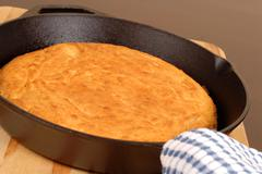 Cornbread made in a cast iron skillet Stock Photos