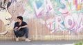 sad young man - wall with graffiti in background Footage