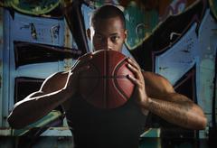 Stock Photo of USA, Utah, Salt Lake City, Portrait of young man with basketball