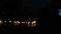 Dark time lapse of city cross road, yellow car lights Stock Footage