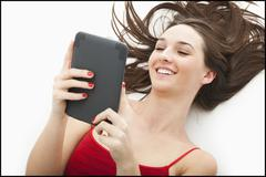 Young woman using electronic organizer - stock photo