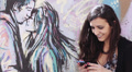 love and happy woman sends a text message to her boyfriend - graffiti HD Footage