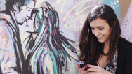 Stock Video Footage of love and happy woman sends a text message to her boyfriend - graffiti