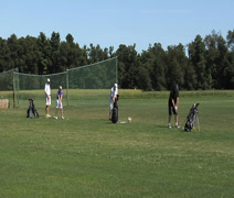 Group practicing golf swing Stock Footage