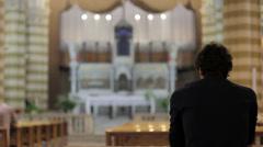 desperate man praying in a church - stock footage