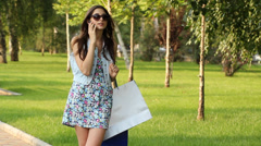 Happy woman after shopping  - stock footage