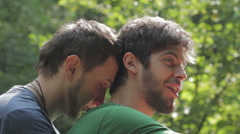 Two young gay man hugging each other - stock footage