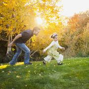 Bountiful, Family with two daughters (2-3, 4-5) playing in garden Stock Photos