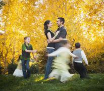Bountiful, Family with children (2-3, 4-5, 6-7, 8-9) dancing in garden at autumn Stock Photos