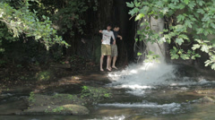 two gay friend have fun near a waterfall: love, homosexual - stock footage