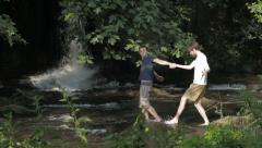 A couple of boys walking in the nature: gay, love, river Stock Footage