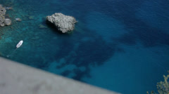 Boat in Clear Water of Azure Bay in Capri Italy - 29,97FPS NTSC Stock Footage