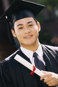 Stock Photo of Graduate with diploma