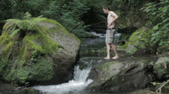 Loving gay couple in a river: outdoor, love, homosexual, river, lifestyle Stock Footage