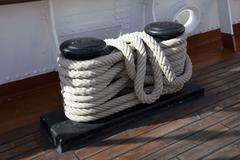 sailboat wooden marine rigs and ropes. - stock photo