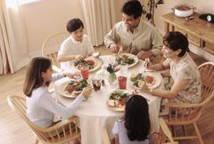 Family eating dinner together Stock Photos