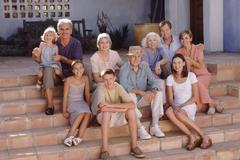 Family portrait on the steps - stock photo