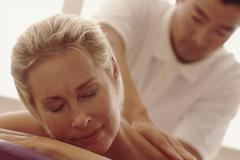 Woman enjoying a massage Stock Photos