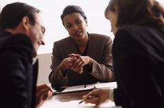 Financial advisor talking to couple - stock photo