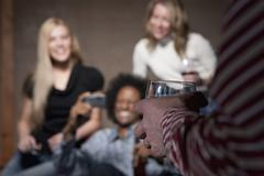 Group of people socializing at a party Stock Photos