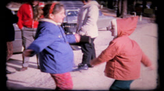 Stock Video Footage of 235 - little girls in roadside twisting contest - vintage film home movie