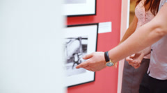 A young couple in a modern art gallery Stock Footage