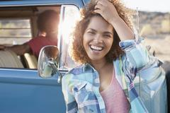 Woman in foreground with friend during their road trip Stock Photos