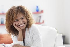 Portrait of mid adult woman relaxing at home Stock Photos