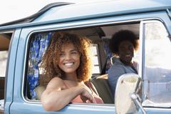 Smiling woman and man in van Stock Photos