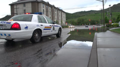 Localized flooding, police car blocks access Stock Footage
