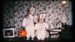 12 - little girls dress in bunny costumes for Halloween -vintage film home movie Stock Footage
