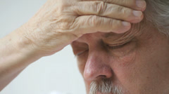 Man with bad headache Stock Footage