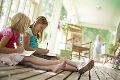 Two girls writing letters Stock Photos