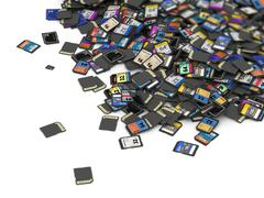 Big heap of SD and microSD memory cards - stock photo