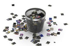 SD and microSD memory cards flow on trashcan - stock photo