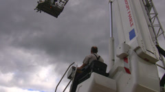 Cherry picker operator at work Stock Footage
