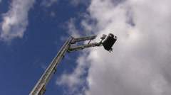 Cherry picker platform going down Stock Footage