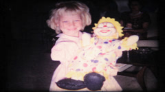 72 - little girl likes her ugly clown - vintage film home movie Stock Footage