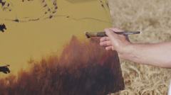 brush of an artist painting a canvas - painter - color - stock footage