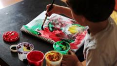 Top view of boy draws paints abstract drawing Stock Footage
