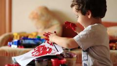 Cute boy leaves his fingerprints on paper Stock Footage