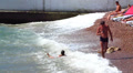 The man photographs the child in sea waves Footage