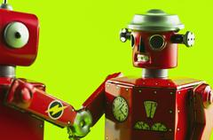 Toy robots shaking hands Stock Photos