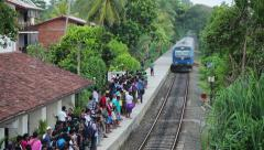 Bentota, sri lanka - apr 28: train arrive to station with waiting people on a Stock Footage
