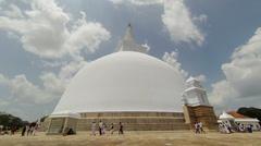Anuranhapura, sri lanka - apr 16: pilgrims in white clothes go round huge whi Stock Footage