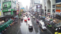 Bangkok, thailand - apr 4: taxi car traffic in the rainy city center with pul Stock Footage