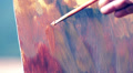 close up of a brush that paints a canvas - painter HD Footage
