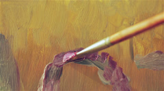 Close up of a brush that paints a canvas - painter Stock Footage