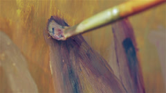 close up of a brush that paints a canvas - painter - stock footage