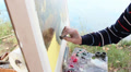 painter paints the river HD Footage